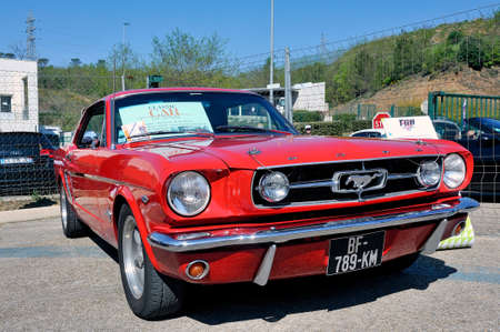 American car gathering at the mechanical pole of the town of Ales in the French department of Gard, here a ford Mustang red