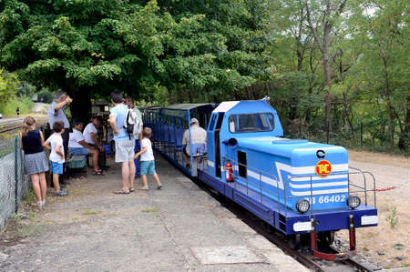 oddity: Small tourist train between Sainte Cecile dAndorge and Saint Julien des Ponts in the French department of Gard offers travelers a walk through woods.