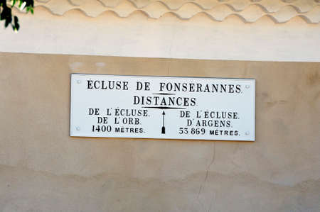 Explanatory plate on a wall at the locks of Fonterannes on the canal du midi near Beziers Reklamní fotografie