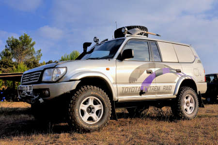 A well-equipped Toyota all-terrain vehicle at sunset