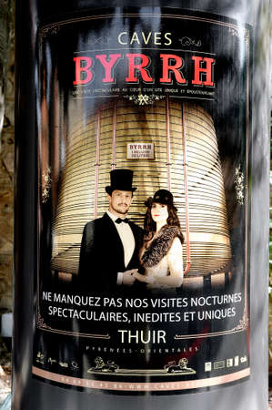 Great bottle of aperitif at the entrance of the cellars of the famous brand Byrrh company known worldwide.