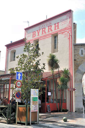 Old entrance facade of the Byrrh factory in Thuir where is today a bistro
