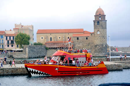 Collioure the Barracuda boardwalk boat with underwater vision boarding its passengers to go out at sea Editorial