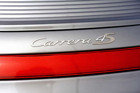back detail on the Carrera 4s logo of a sports car Gray porche on a parking lot of the city of Ales in the Gard department