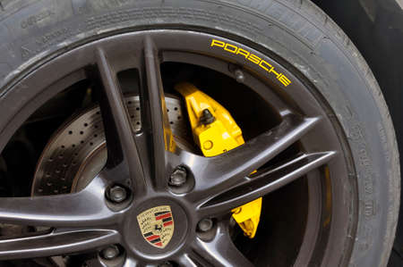 detail of a wheel of a Porsche white convertible sports car