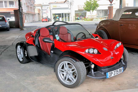 a red Secma sports car on a parking lot of the city of Ales in the department of Gard Editöryel