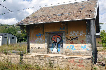 Small railway station building vandalized and abandoned