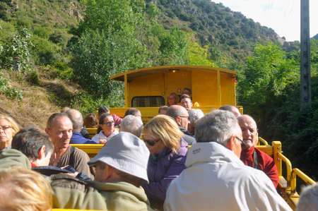 the traveler in the discovered wagon of the yellow Pyrénnées train