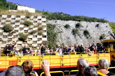 Two small yellow trains from the Pyrenees crossing each other to the delight of travelers