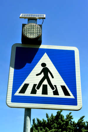 sign indicating a protected crossing on the road for pedestrians Editorial