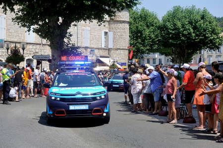 Passage of a car of the gendarmerie in the caravan of the Tour de France in Anduze