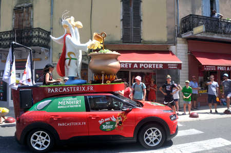 Passage of an advertising car of Parc Asterix in the caravan of the Tour de France in Anduze Editorial