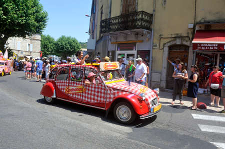 Passage of an advertising car of Cochonou in the caravan of the Tour de France in Anduze