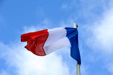 The french flag fluttering in the wind on a sky background