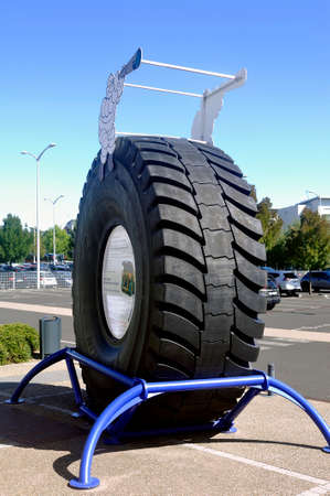 Large tire of mine engine exposed at the entrance of the Michelin Museum in Clermont-Ferrand Redactioneel