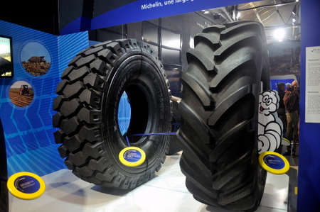 Tires of heavy construction machinery exposed at the exit of the visit of the Michelin Museum in Clermont-Ferrand