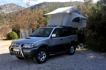 All terrain car with a roof tent unfolded on the roof Stock fotó