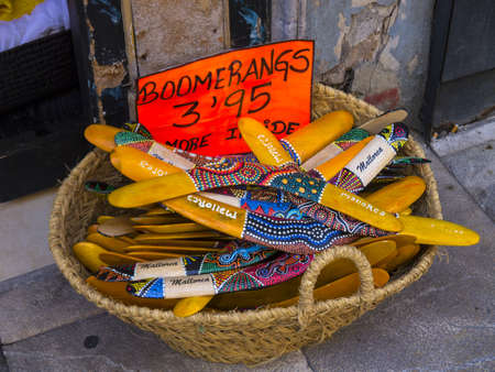 boomerangs: Elaborately painted boomerangs in a basket outside a shop in Palma city Stock Photo
