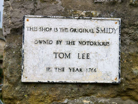 wharfedale: A plaque on the wall of the Smithy telling of the murderer Tom Lee in the village of Grassington Yorkshire