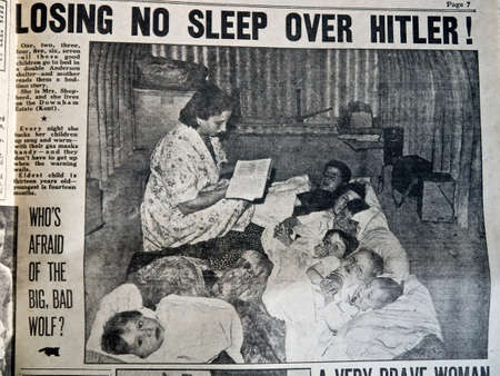raid: Losing no sleep over Hitler children sleeping in an air raid shelter newspaper cutting from the 1940s