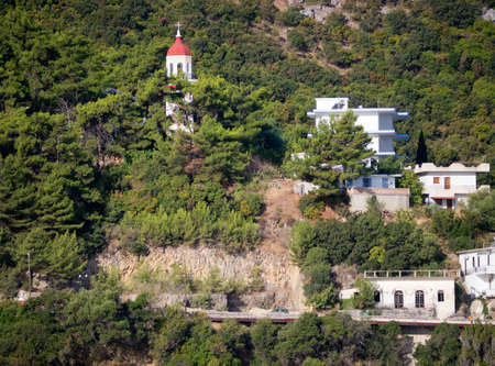kefallonia: Olympian coastline buildings on the boat to Ithaca Greece