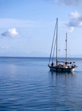 kefallonia: Sailing boat cruising on tranquil Ionian seas in Greece Editorial