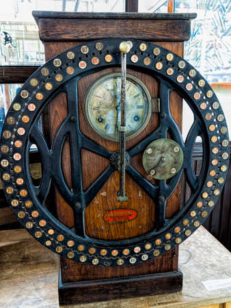 A clocking in machine from a Victorian factory