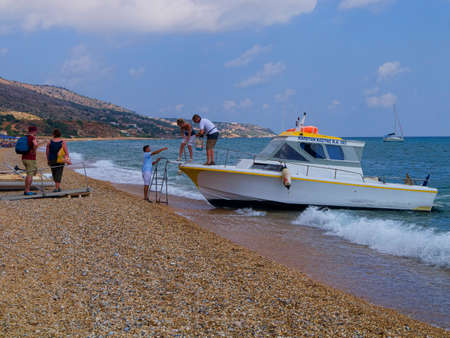 catching taxi: Catching a water taxi in Kefalonia Greece