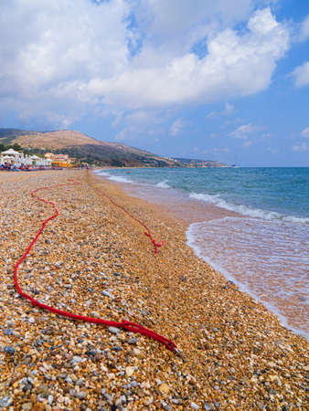 kefallonia: Red ropes on the beach at Skala Kefalonia in Greece