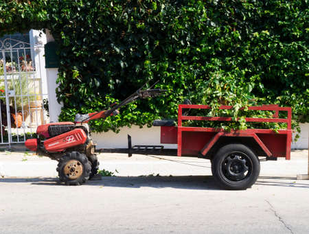 Unique mini tractor and trailer on the main street of Skala Kefalonia in Greece
