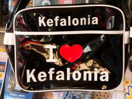 kefallonia: Black PVC bag, I love Kefalonia hung up in a Skala village shop Editorial