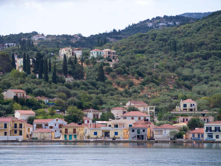 Pretty colourful traditional houses on the coastline of ithaca Greece photo