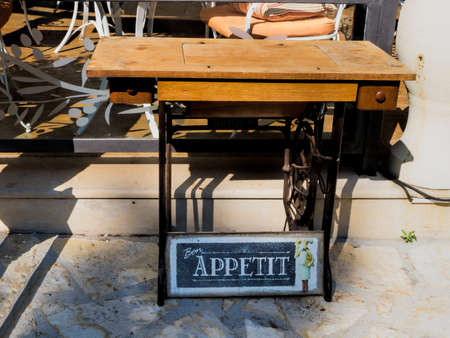 kefallonia: A treadle sewing machine advertising outside a restaurant in the village of Skala in Kefalonia Greece Stock Photo