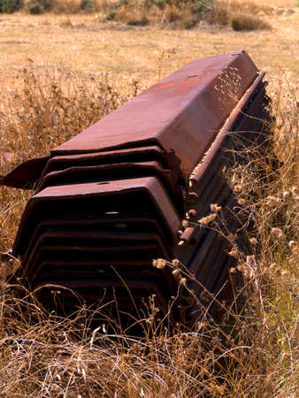 kefallonia: Rusted girders abandoned in a field