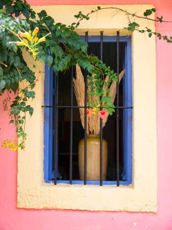 Pretty window display in the village of Fiskardo on the Island of Kefalonia in Greece photo