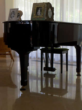 ivories: Reflections of a Baby Grand piano in the reception area of the Hotel Cala Blanca in Palma Nova on the Island of Mallorca in Spain Editorial