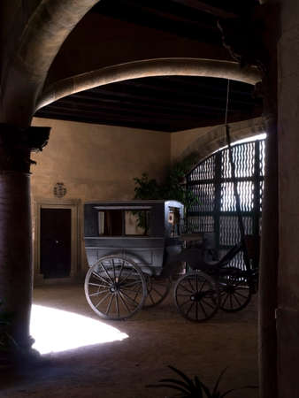 await: Carriages await their owners inside Can Sureda