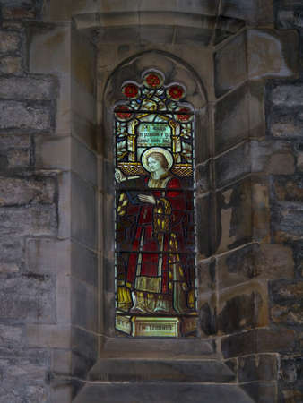 poor man: One of the stained glass windows at St. Leonards Church in Downham Lancashire, that were known as Poor man\\ Editorial