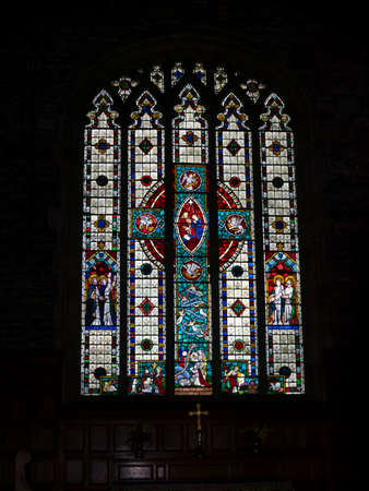 lancashire: One of the stained glass windows at St. Leonards Church in Downham Lancashire, that were known as Poor man\\ Editorial