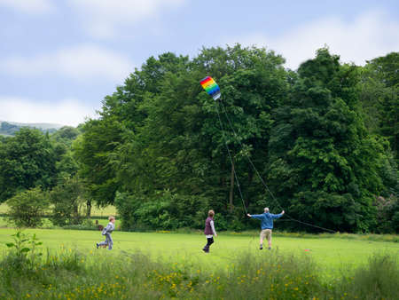 entertaining: Lets fly a kite, a family enjoying an entertaining time at the park