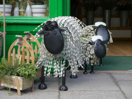 cumbria: Metal sheep stood outside a Keswick flower shop in Cumbria