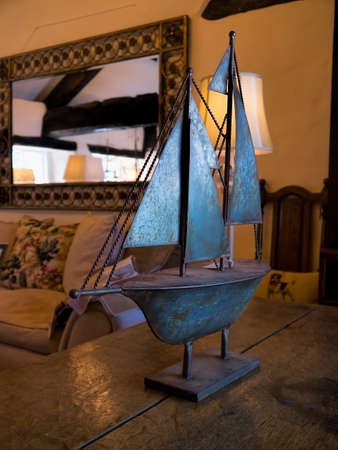 furniture shop: Stylish ornamental yacht on display in the antique furniture shop John Young in the Lakeland town of Keswick Stock Photo