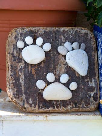 artwork: Pebble footprints artwork Stock Photo