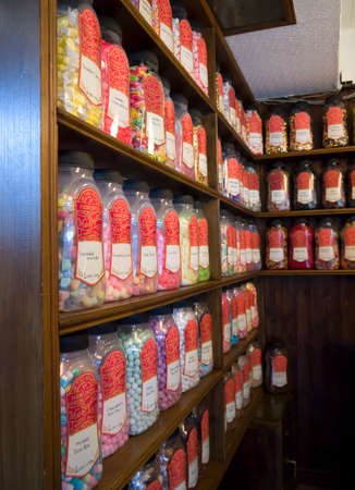 mrs: An arrangement of many jars of sweets on shelves in Mrs  Beightons sweet shop in the village of Haworth inYorkshire