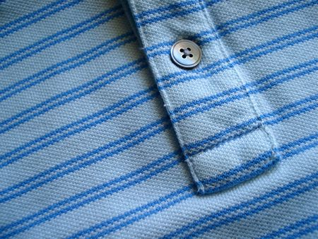 Blue Cotton Shirt with Single Blue Button Stock Photo