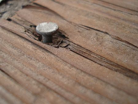 Nail Coming out of Board Stock Photo