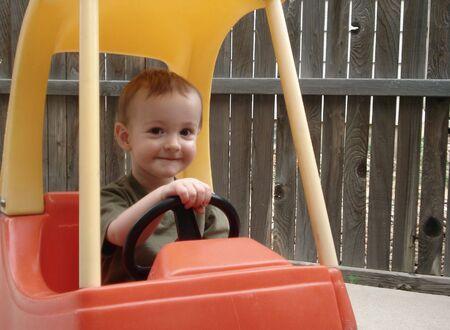 Cute Boy Drives Toy Car
