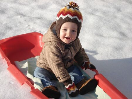 Cute Little Boy Plays in the Snow