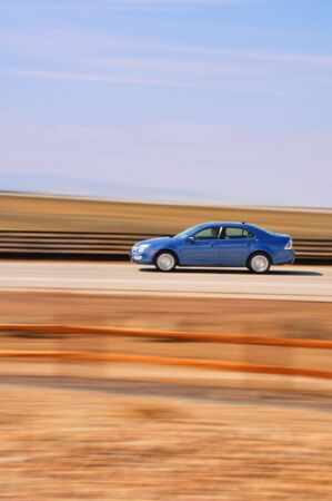Blue Car with Blurred Background Stock Photo - 4712234