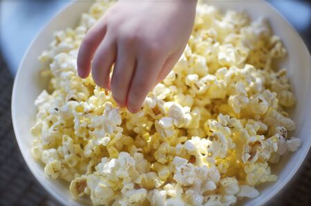 Hand Grabbing Popcorn
